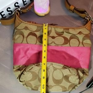 Pink stripped, tan signature Coach shoulder purse!